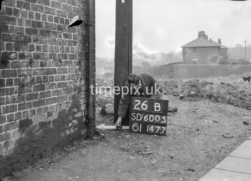 SD600526B, Man marking Ordnance Survey minor control revision point with an arrow in 1950s