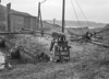 SD580376A, Man marking Ordnance Survey minor control revision point with an arrow in 1950s