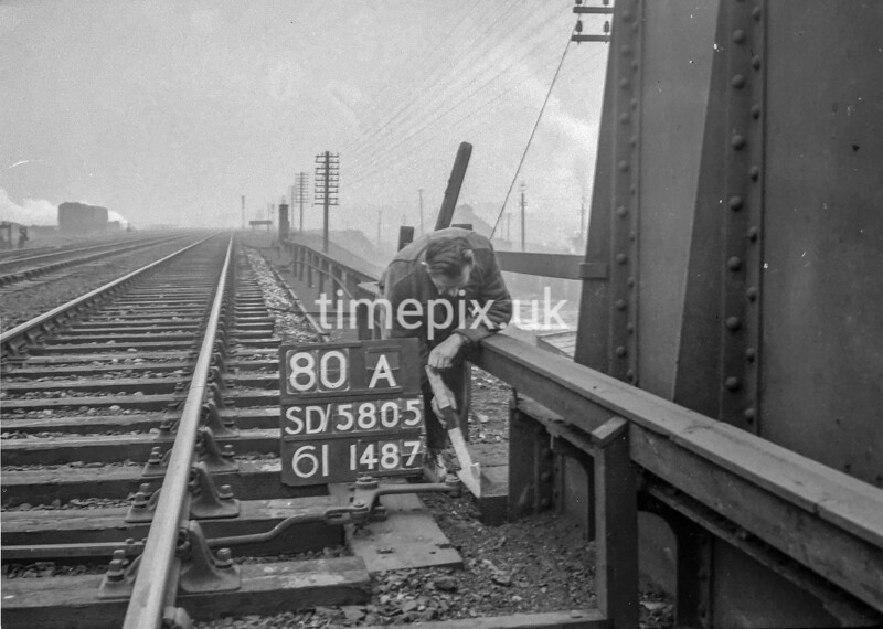 SD580580A, Man marking Ordnance Survey minor control revision point with an arrow in 1950s