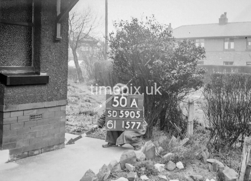 SD590550A, Man marking Ordnance Survey minor control revision point with an arrow in 1950s