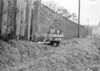 SD600517B, Man marking Ordnance Survey minor control revision point with an arrow in 1950s