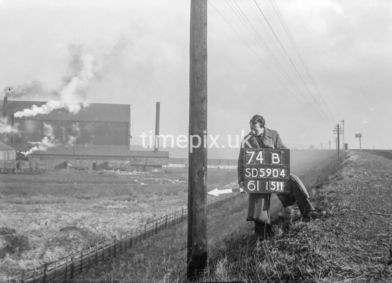 SD590474B, Man marking Ordnance Survey minor control revision point with an arrow in 1950s