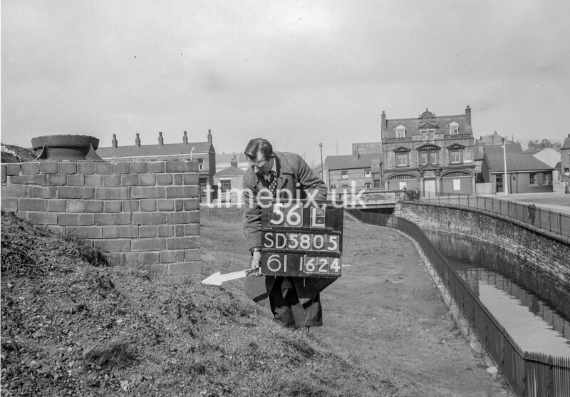 SD580556L, Man marking Ordnance Survey minor control revision point with an arrow in 1950s