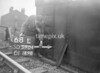 SD590468L, Man marking Ordnance Survey minor control revision point with an arrow in 1950s