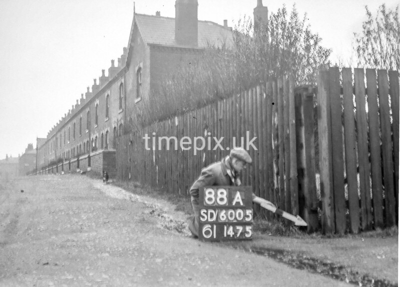SD600588A, Man marking Ordnance Survey minor control revision point with an arrow in 1950s