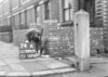SD590374A, Man marking Ordnance Survey minor control revision point with an arrow in 1950s