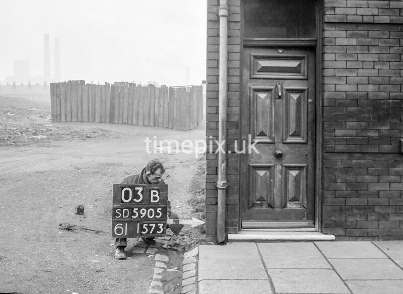 SD590503B, Man marking Ordnance Survey minor control revision point with an arrow in 1950s