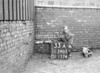SD590533A, Man marking Ordnance Survey minor control revision point with an arrow in 1950s