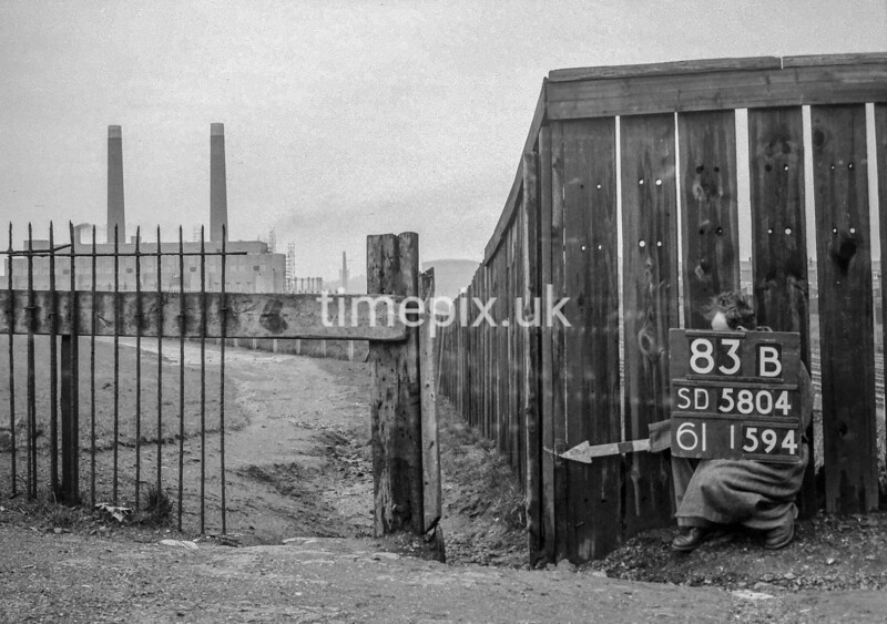 SD580483B, Man marking Ordnance Survey minor control revision point with an arrow in 1950s