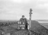 SD590494A, Man marking Ordnance Survey minor control revision point with an arrow in 1950s