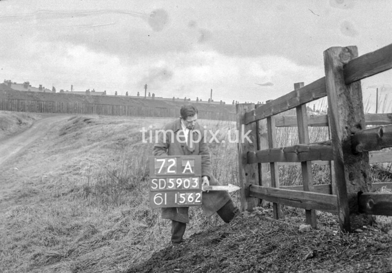 SD590372A, Man marking Ordnance Survey minor control revision point with an arrow in 1950s