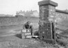 SD590446A, Man marking Ordnance Survey minor control revision point with an arrow in 1950s