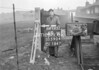 SD590449W, Man marking Ordnance Survey minor control revision point with an arrow in 1950s