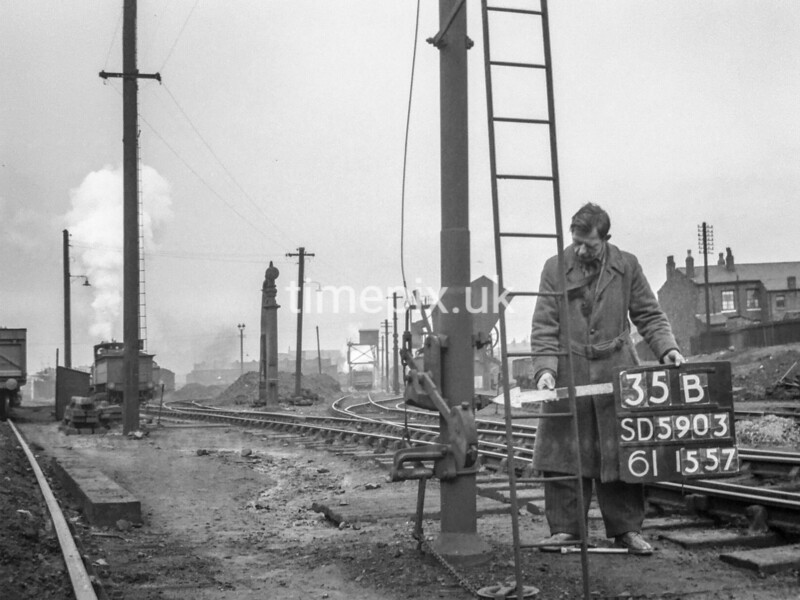SD590335B, Man marking Ordnance Survey minor control revision point with an arrow in 1950s