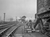 SD590335A, Man marking Ordnance Survey minor control revision point with an arrow in 1950s
