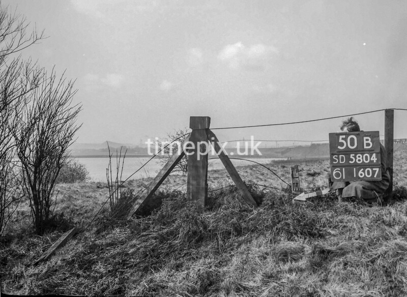 SD580450B, Man marking Ordnance Survey minor control revision point with an arrow in 1950s