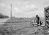 SD600478A, Man marking Ordnance Survey minor control revision point with an arrow in 1950s