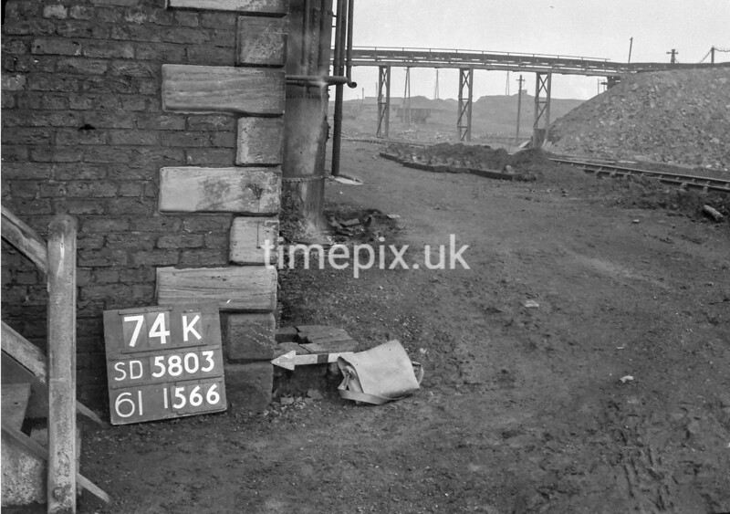 SD580374K, Man marking Ordnance Survey minor control revision point with an arrow in 1950s