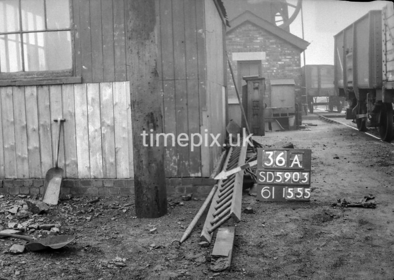 SD590336A, Man marking Ordnance Survey minor control revision point with an arrow in 1950s