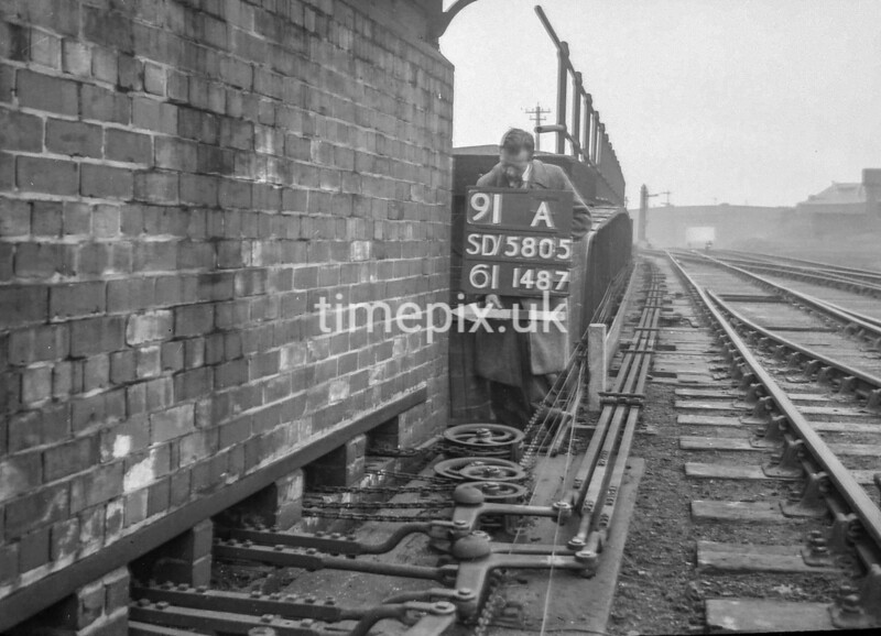 SD580591A, Man marking Ordnance Survey minor control revision point with an arrow in 1950s