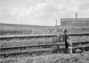 SD600405A, Man marking Ordnance Survey minor control revision point with an arrow in 1950s