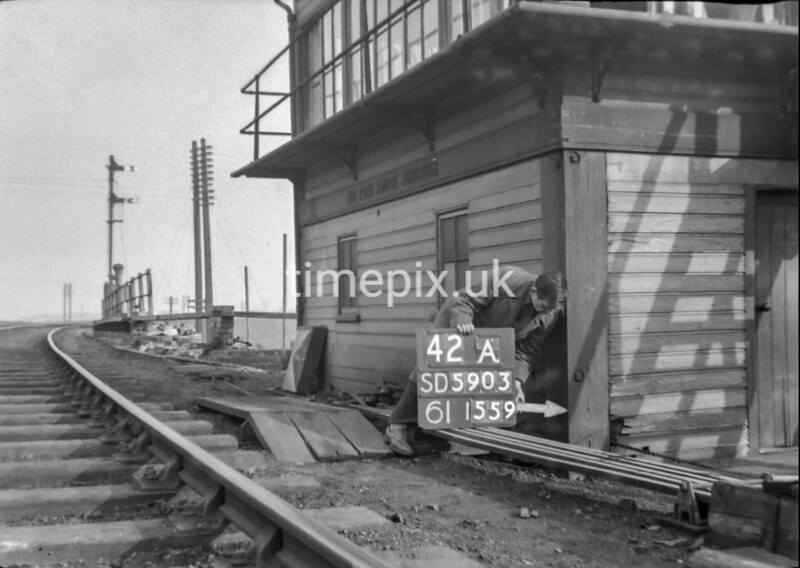 SD590342A, Man marking Ordnance Survey minor control revision point with an arrow in 1950s