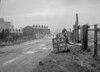 SD580465A, Man marking Ordnance Survey minor control revision point with an arrow in 1950s