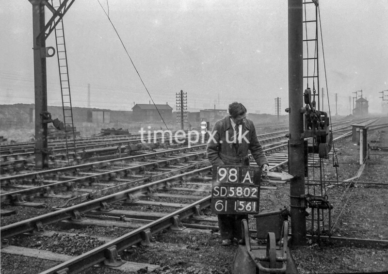 SD580298A, Man marking Ordnance Survey minor control revision point with an arrow in 1950s