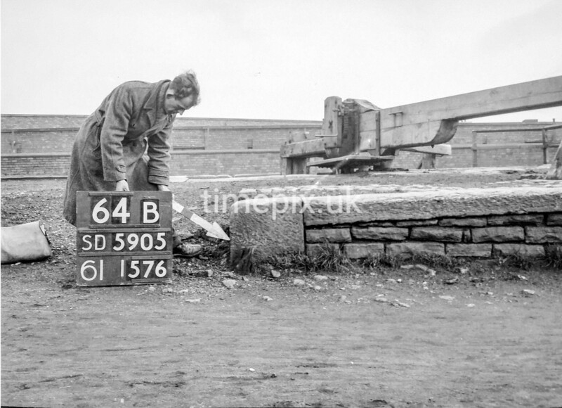 SD590564B, Man marking Ordnance Survey minor control revision point with an arrow in 1950s