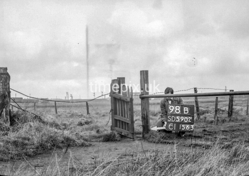 SD590298B, Man marking Ordnance Survey minor control revision point with an arrow in 1950s