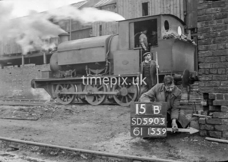 SD590315B, Man marking Ordnance Survey minor control revision point with an arrow in 1950s