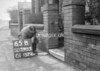 SD590365B, Man marking Ordnance Survey minor control revision point with an arrow in 1950s