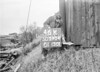 SD590446K, Man marking Ordnance Survey minor control revision point with an arrow in 1950s