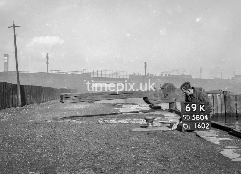 SD580469K, Man marking Ordnance Survey minor control revision point with an arrow in 1950s