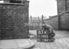 SD590583K, Man marking Ordnance Survey minor control revision point with an arrow in 1950s