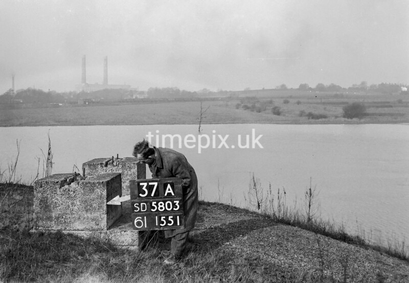 SD580337A, Man marking Ordnance Survey minor control revision point with an arrow in 1950s