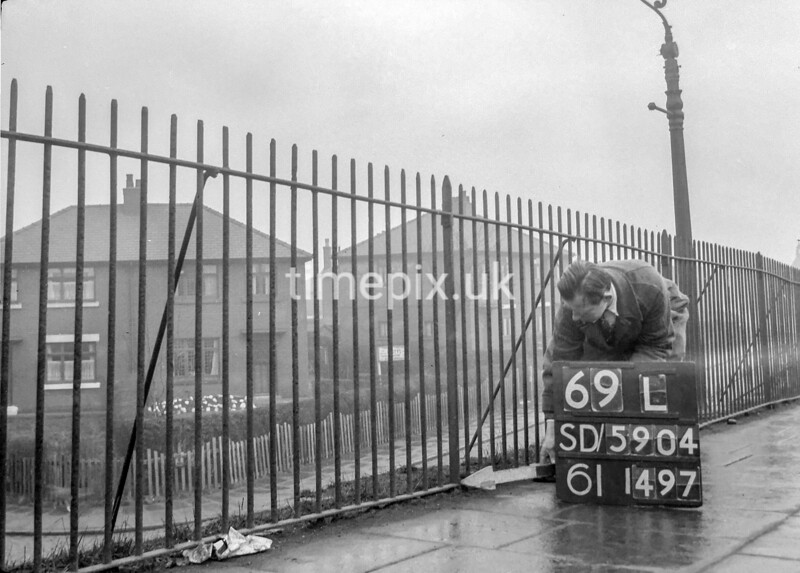 SD590469L, Man marking Ordnance Survey minor control revision point with an arrow in 1950s