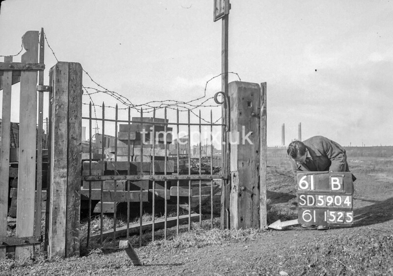 SD590461B, Man marking Ordnance Survey minor control revision point with an arrow in 1950s