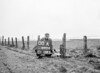SD600400A, Man marking Ordnance Survey minor control revision point with an arrow in 1950s