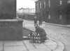SD590570A, Man marking Ordnance Survey minor control revision point with an arrow in 1950s