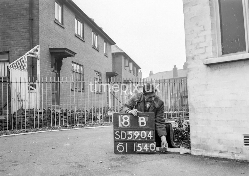 SD590418B, Man marking Ordnance Survey minor control revision point with an arrow in 1950s