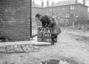 SD590572A, Man marking Ordnance Survey minor control revision point with an arrow in 1950s