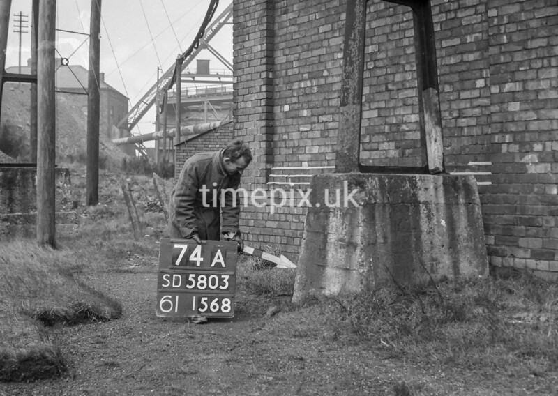 SD580374A2, Man marking Ordnance Survey minor control revision point with an arrow in 1950s