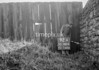 SD580492A, Man marking Ordnance Survey minor control revision point with an arrow in 1950s
