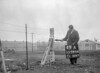 SD590449A, Man marking Ordnance Survey minor control revision point with an arrow in 1950s