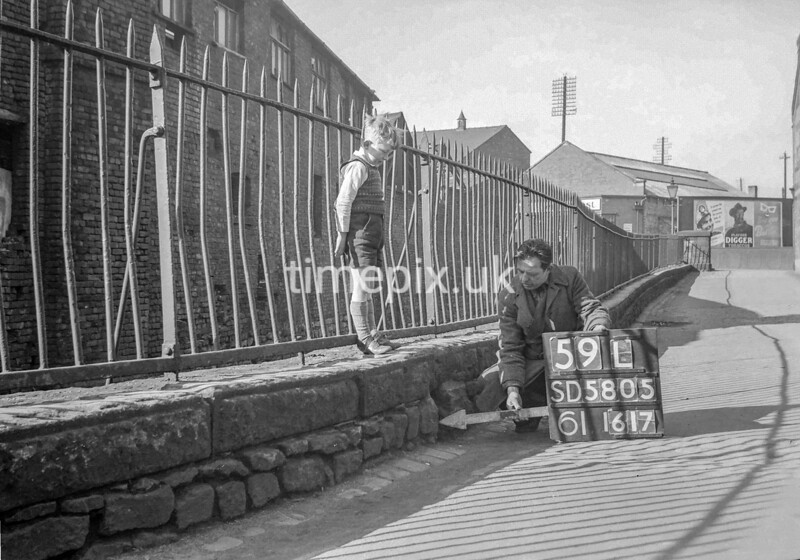 SD580559L, Man marking Ordnance Survey minor control revision point with an arrow in 1950s