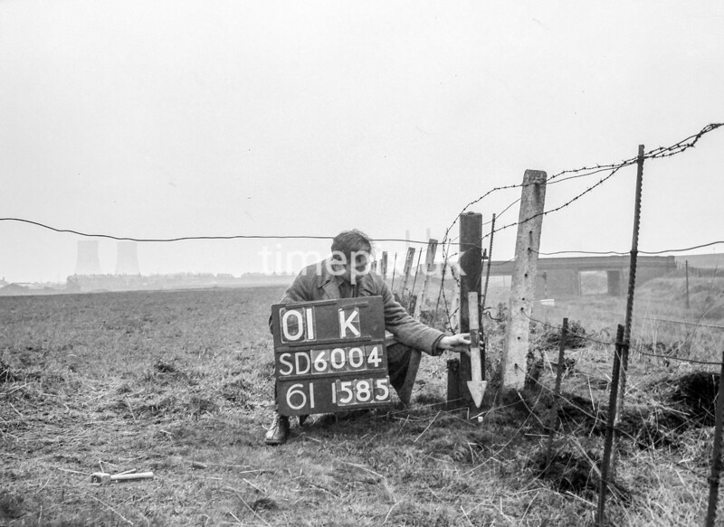 SD600401K, Man marking Ordnance Survey minor control revision point with an arrow in 1950s