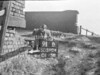 SD590491B, Man marking Ordnance Survey minor control revision point with an arrow in 1950s