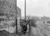SD600508A, Man marking Ordnance Survey minor control revision point with an arrow in 1950s