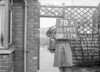 SD590578A, Man marking Ordnance Survey minor control revision point with an arrow in 1950s